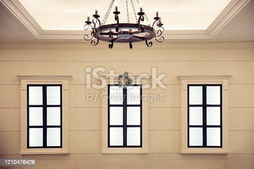 521806786 istock photo Old room with three windows 1210476426