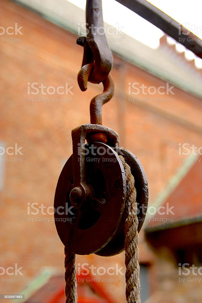 Old rope and iron blocks stock photo