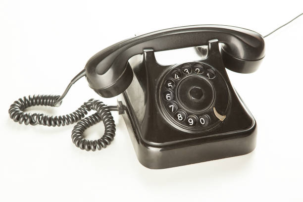 Old rotary phone on white background stock photo