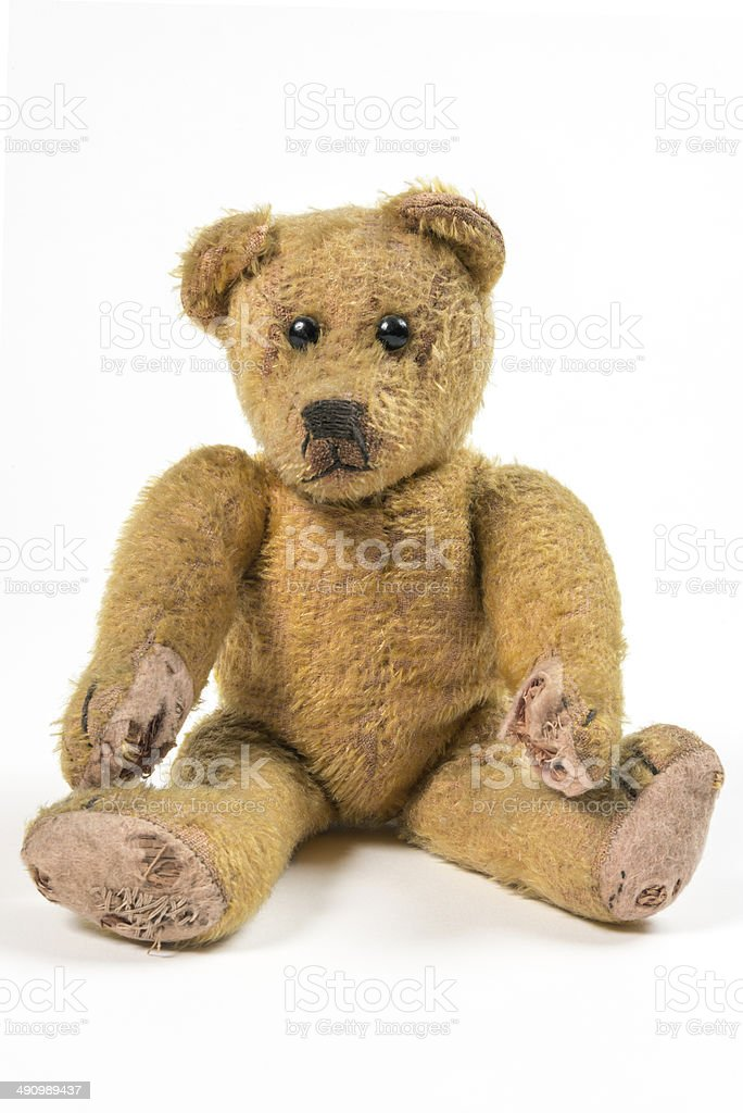 Old rotten straw Teddy bear stock photo