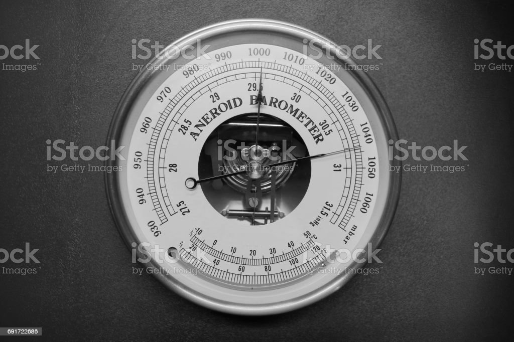 Old round barometer meter isolated over black background stock photo