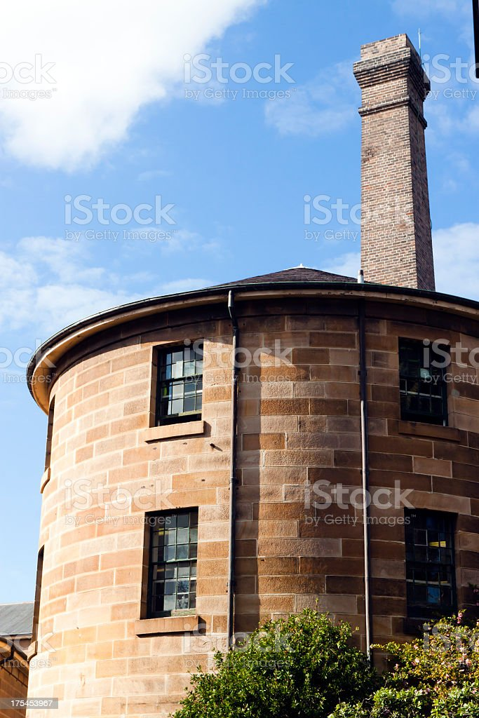 Old round stone jail building with tower, against sky royalty-free stock photo