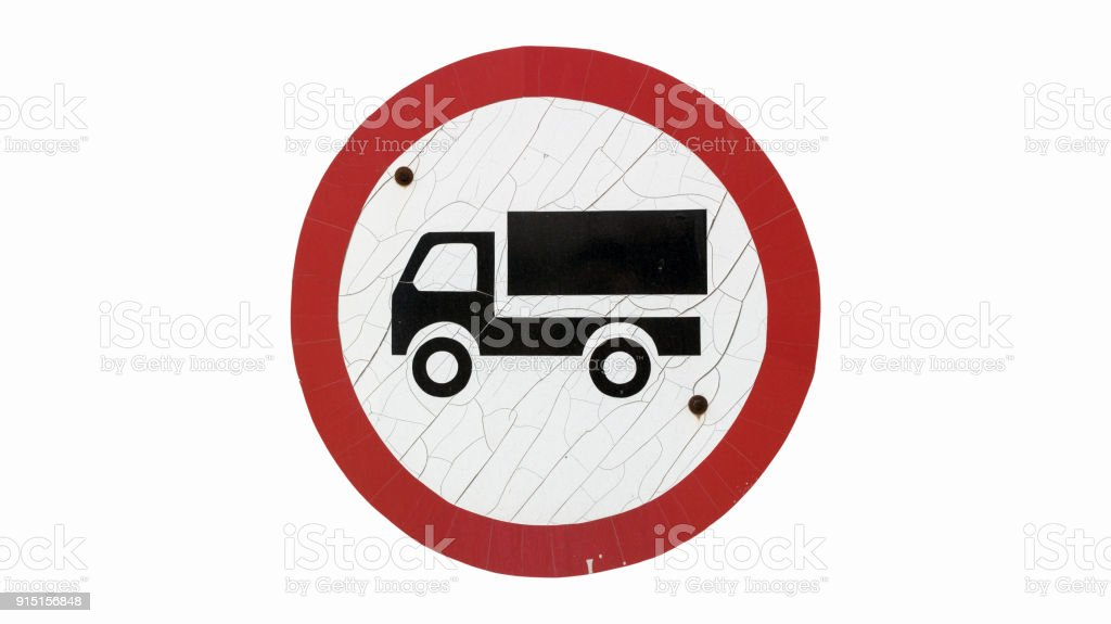 Old round with cracks road sign 'No goods vehicle' isolated on white. stock photo