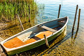 old row boat at a harbor