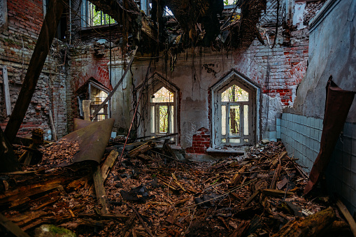 Old ruined abandoned historical mansion in Gothic style.