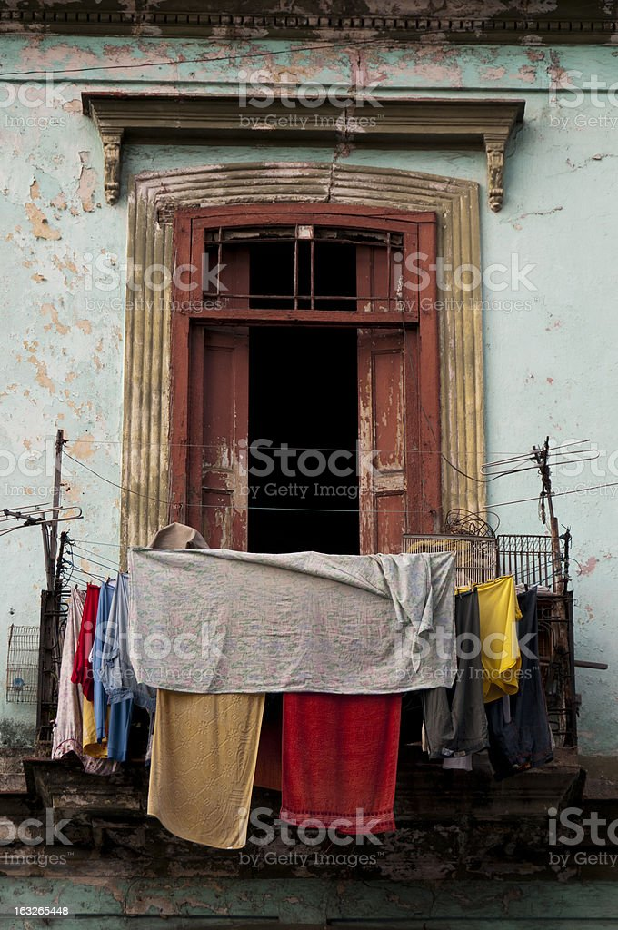 Old ruined balcony with washed clothes drying in the air stock photo