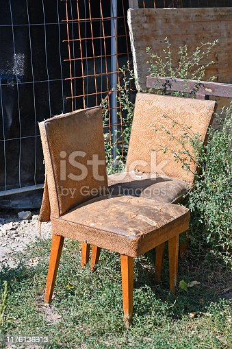 Old ruined chairs outdoors