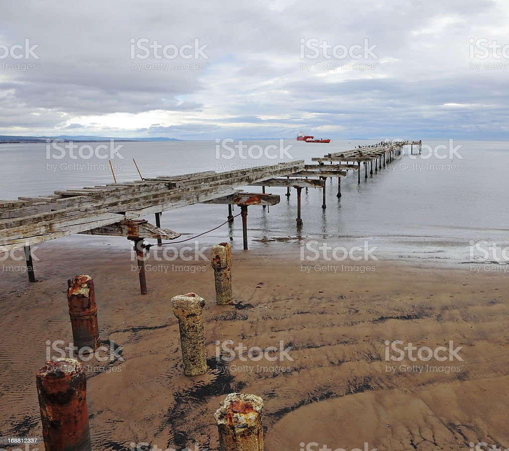 Old ruined pier in the Strait of Magellan. royalty-free stock photo