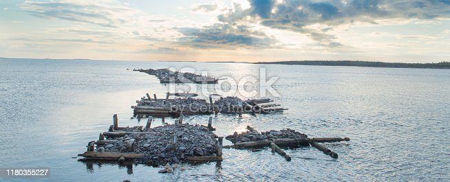 Old ruined pier on the shores of the White sea.
