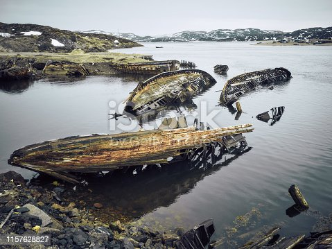 Old ruined wooden ship, shore of the Barents Sea, Teriberka, Kola Peninsula, Russia