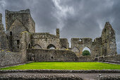 istock Old ruins of Hore Abbey with remaining arches and walls, dramatic storm sky 1314141695