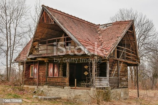 Landscape of old abandoned farm house in autumn season. Old broken house.