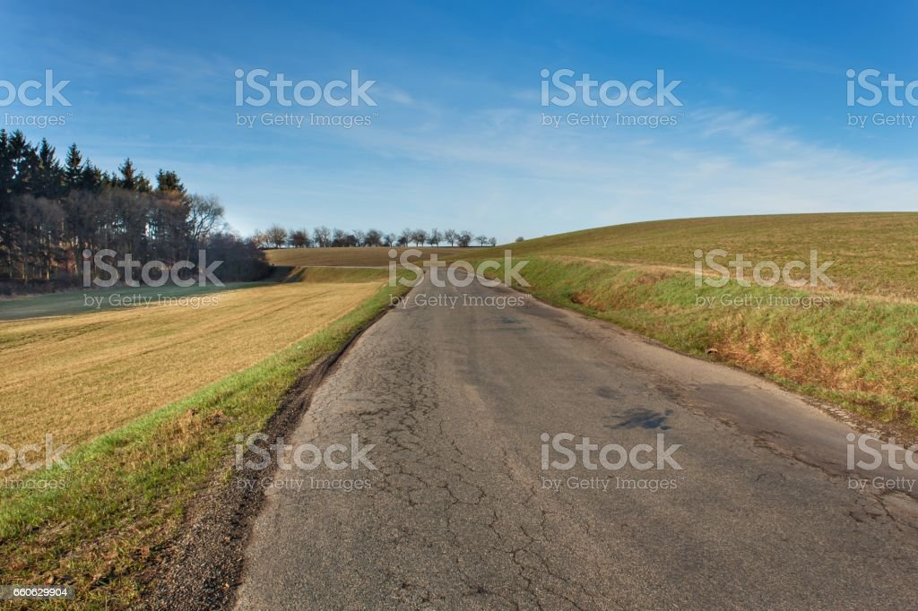 Old rural asphalt road in the Czech Republic. stock photo