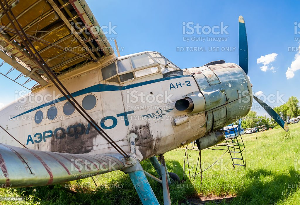 Old russian aircraft An-2 at an abandoned aerodrome stock photo