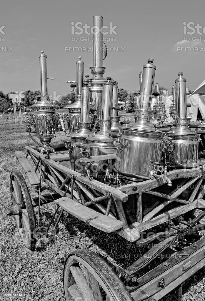Old Russian samovar on a wooden cart stock photo