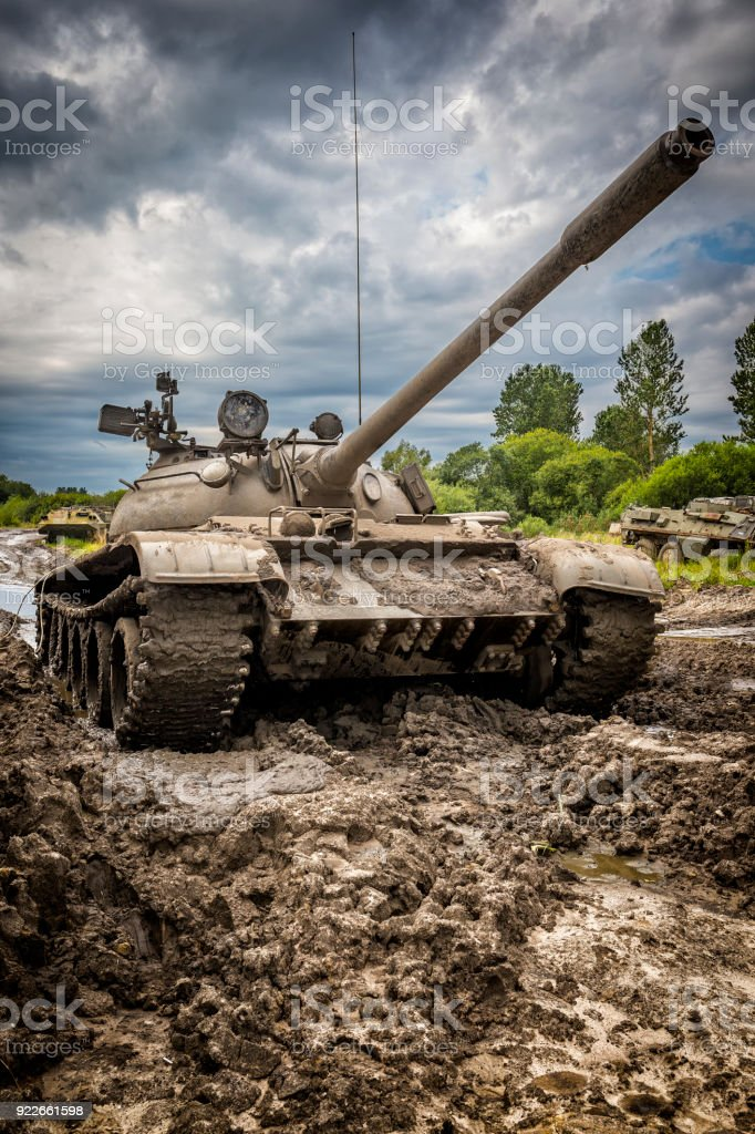 Old Russian tank T-55 on military training ground stock photo