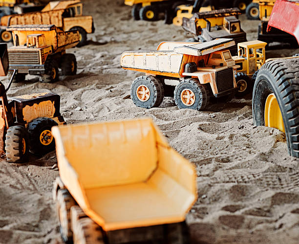 Old, Rusted Construction Toys in Sandbox stock photo