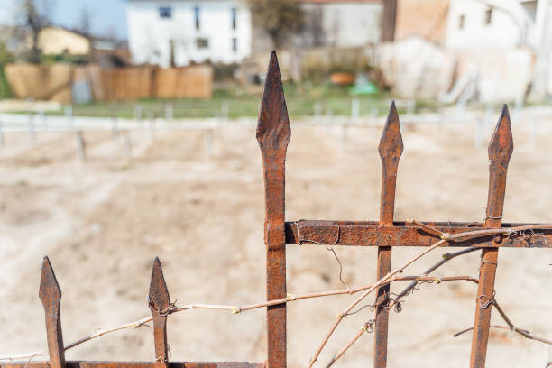old rusted fence in a small town stock photo