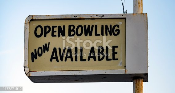 istock Old Rusted Lighted Sign at Recreation Center says Open Bowling 1177271912