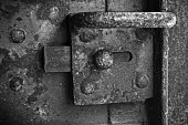 istock Old rusted lock mounted on steel door 921867440