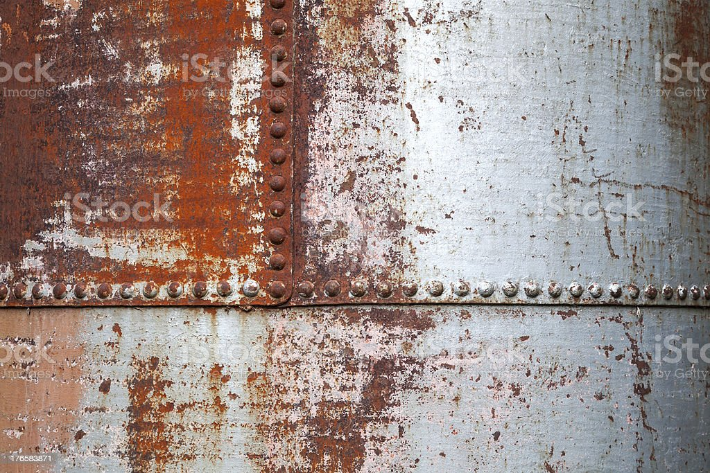 Old rusted metal background texture with rivets royalty-free stock photo