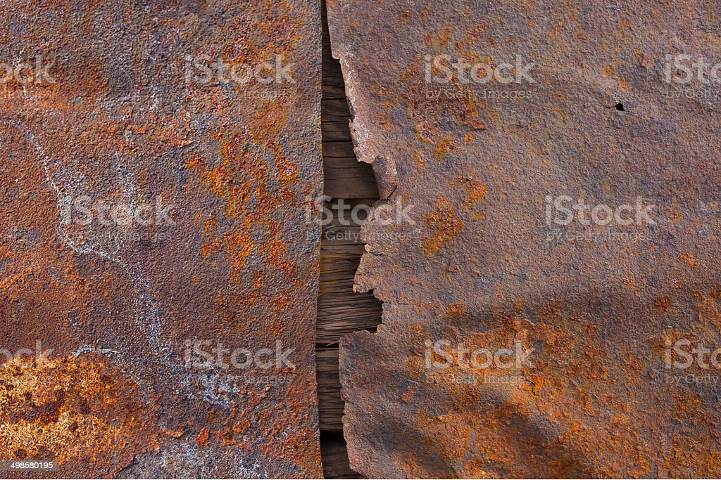 Old rusted metal surface texture with wood royalty-free stock photo