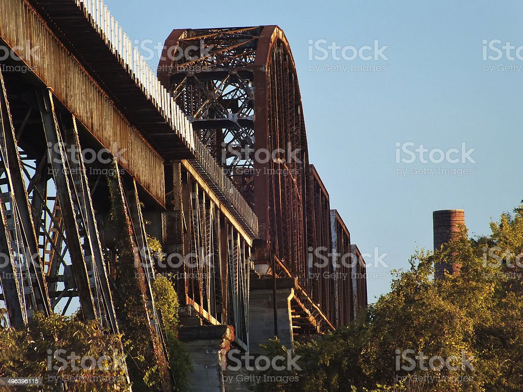 Old rusted metal train bridge stock photo