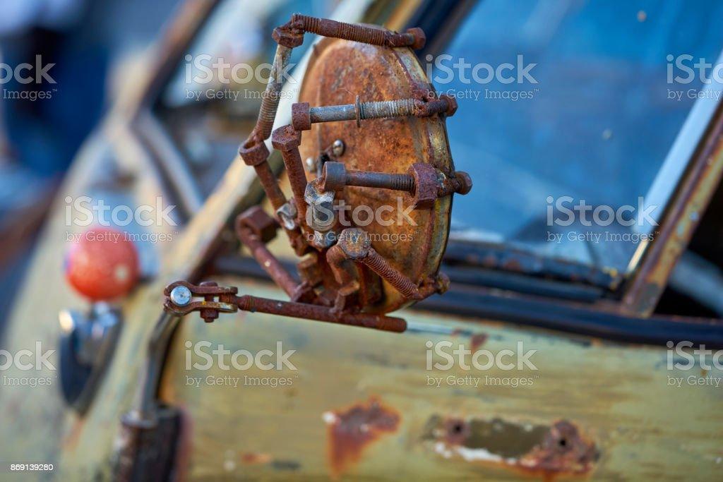 old rusted mirror on vintage weathered German vehicle stock photo