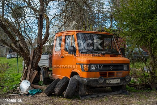 istock Old rusted scrap retro car that have been abandoned. 1279659138