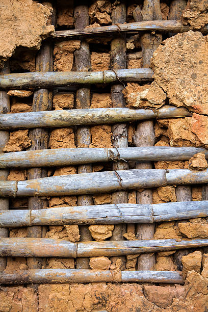 Old rustic cob wall with wood and mud stock photo