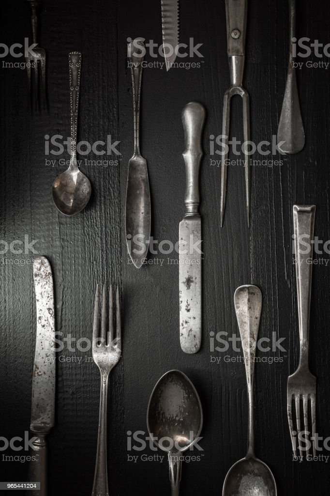 Old Rustic Cutlery on Dark Wooden Background. Kitchen and Food Concept. zbiór zdjęć royalty-free