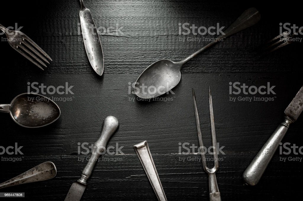 Old Rustic Cutlery on Dark Wooden Background. Kitchen and Food Concept. royalty-free stock photo