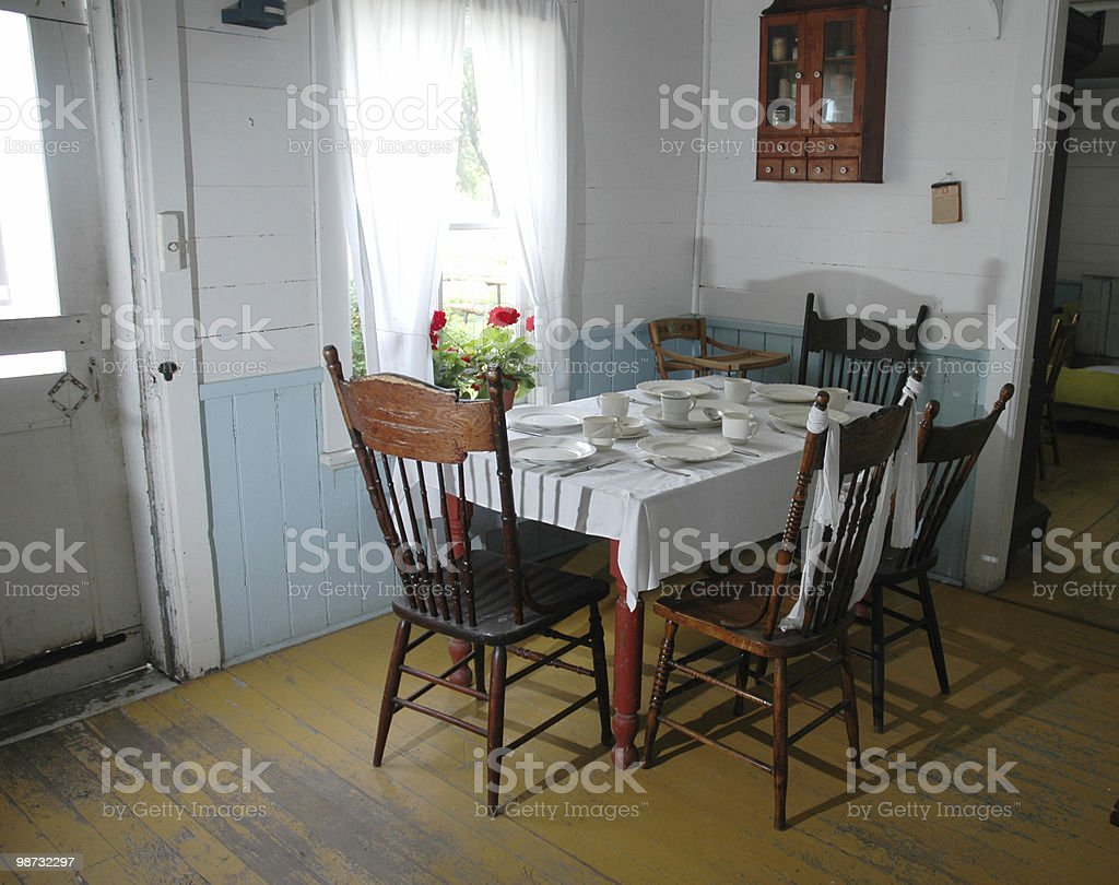 Old rustic kitchen with wooden chairs stock photo