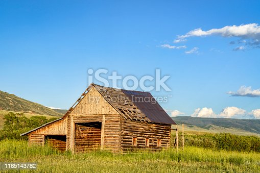old, rustic, log barn in Colorado's Rocky Mountains