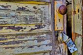 istock Old, rustic, partially open door with broken latch 521033756