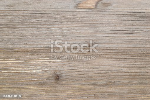 istock Old rustic scratch and damage grey wood texture close-up as background. 1068031818
