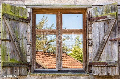 istock Old rustic window of a traditional farm 1074188172
