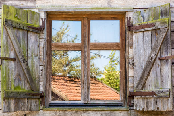 Old rustic window of a traditional farm stock photo