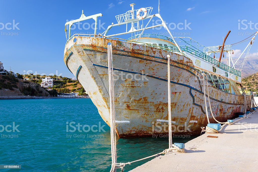 Old rusty abandoned ship in port of Aghia Galini stock photo