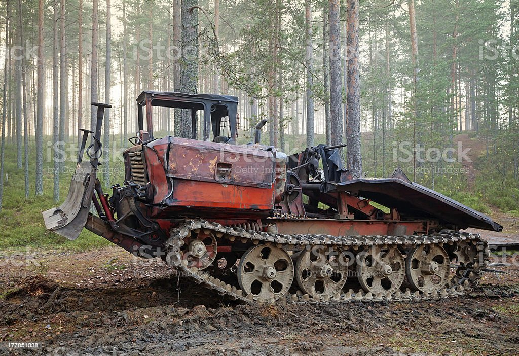 Old rusty all-terrain vehicle on tracks royalty-free stock photo