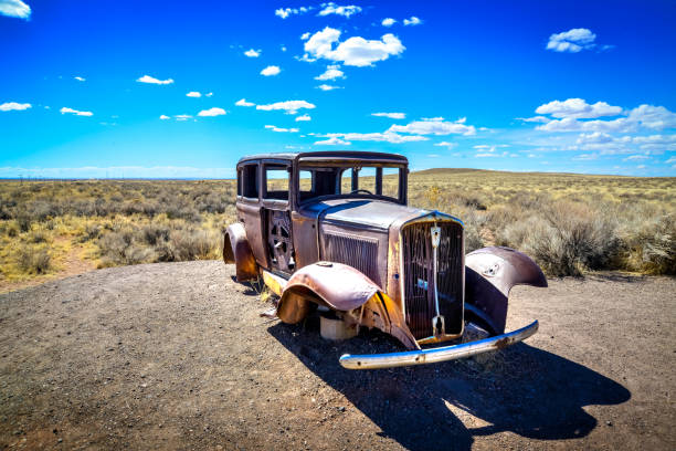 Old rusty and abandoned car in the Arizona desert USA stock photo