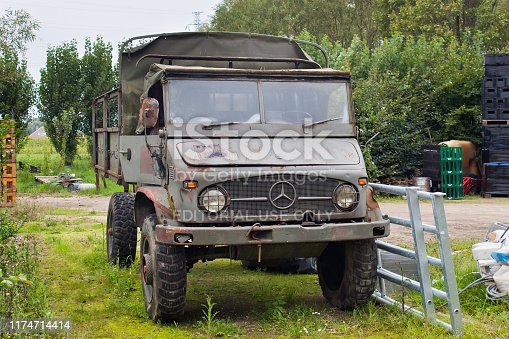 istock Old rusty army truck the Unimog 404. The truck is a vehicle of the Unimog-series by Mercedes-Benz, produced in the plant in Gaggenau from 1955 to 1980. 1174714414