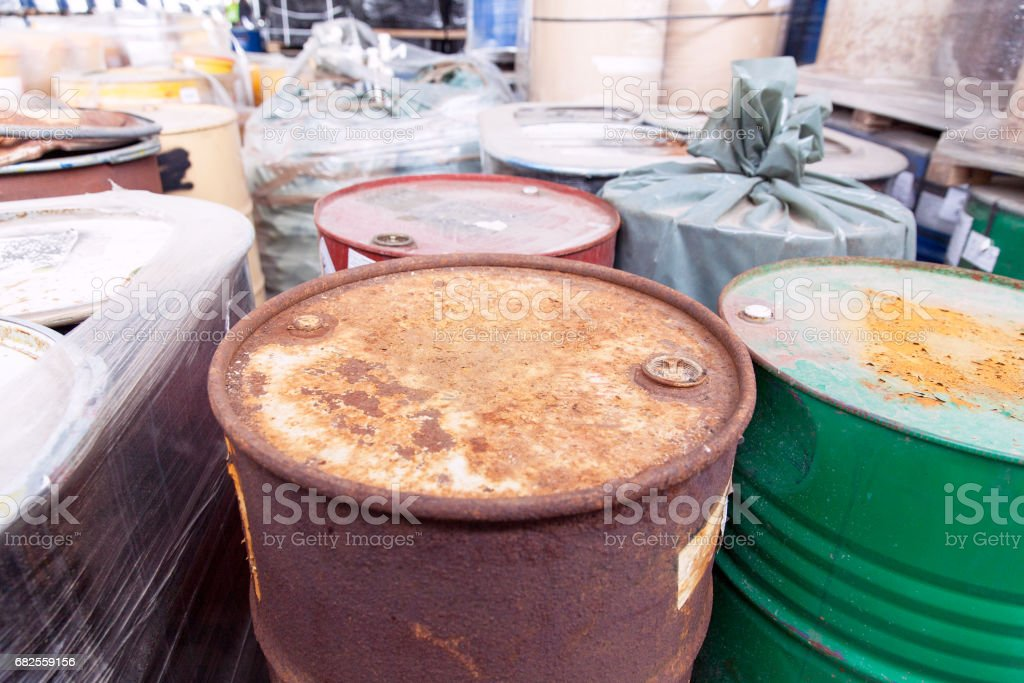 Old, rusty barrels with toxic chemical waste royalty-free stock photo