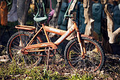istock Old rusty bicycle for children used as a decorative object in a garden 1147539526