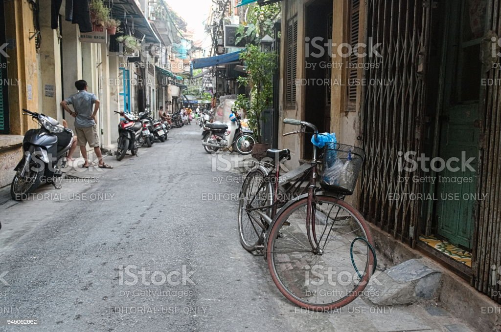 Old rusty bicycle on the treet in Hanoi stock photo