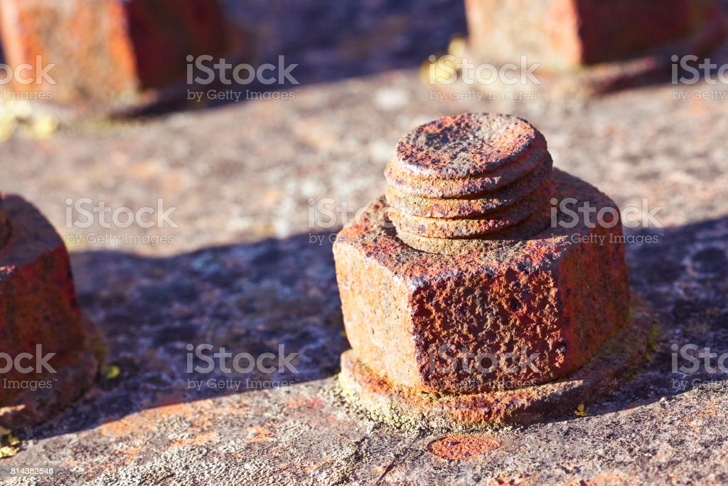 Old rusty bolt with threaded metal bar - image with copy space stock photo