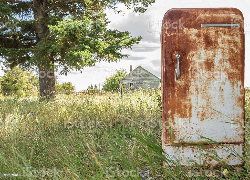 old rusty broken fridge stock photo