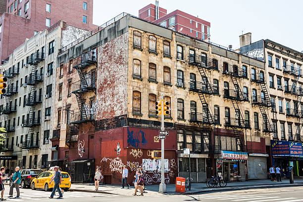 Old, rusty building with graffiti in Chinatown in NYC stock photo