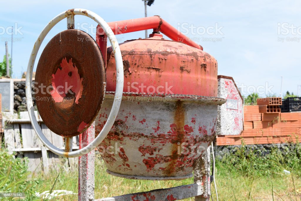 Old rusty cement mixer on construction site royalty-free stock photo