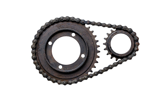 Old rusty chain gear, small and large collars. Isolated on a white background